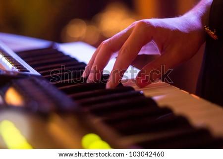 To shells keyboard hand - stock photo
