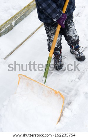 to shovel snow  - stock photo