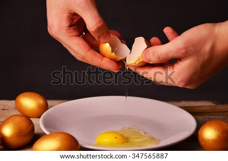 to smash the Golden egg on wooden background