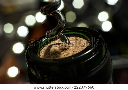 To Uncork A Bottle of Wine On Silvester - stock photo