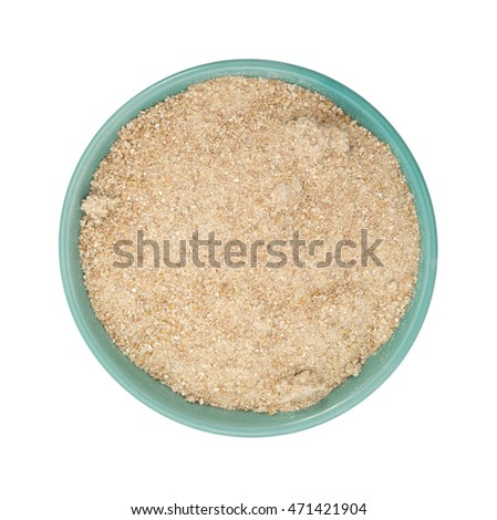 To view of a bowl filled with stone ground whole wheat muffin mix on a white background.