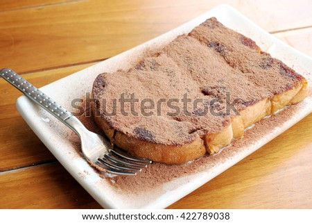 Toast and cocoa powder - stock photo
