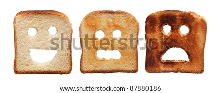 Toast bread differently burned - summer skin care concept, isolated - stock photo
