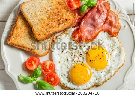 Toast, eggs and bacon for breakfast - stock photo