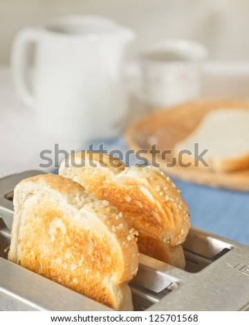 Toast in toaster in simple breakfast setting