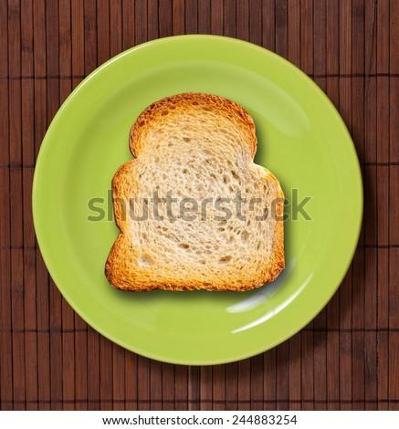 Toast on green plate. Studio shot. - stock photo