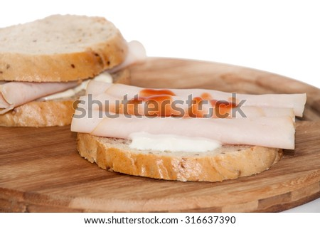 Toast sandwich with turkey breasts and ketchup.