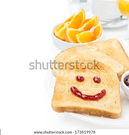 Toast with a smile of jam, coffee, orange juice and fresh oranges for breakfast, isolated on white background, close-up - stock photo