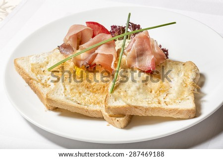 Toast with butter and ham - stock photo