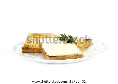 toast with butter on plate isolated on white background