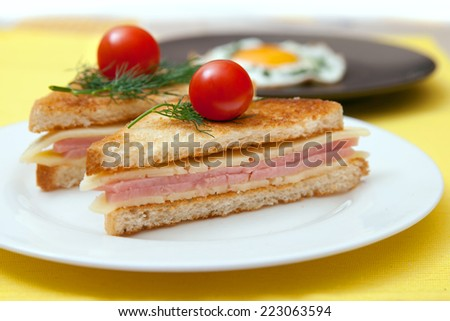 toast with cheese and ham on the table - stock photo