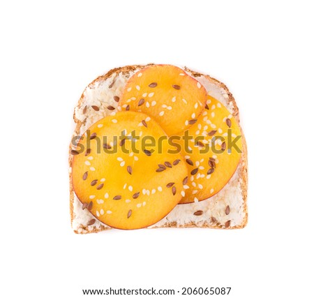 Toast with peach fruit for breakfast meal. Isolated on a white background.