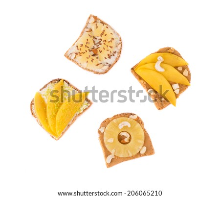 Toast with pineapple fruit for breakfast meal. Isolated on a white background. - stock photo