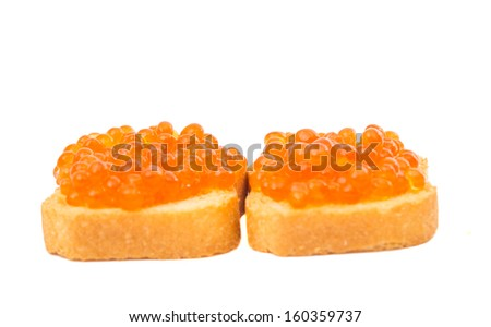 toast with red caviar isolated on white background