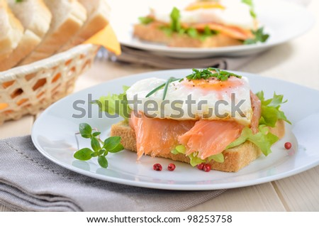 Toast with smoked salmon and heart shaped fried egg - stock photo