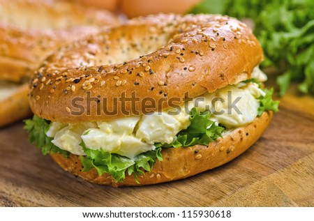 Toasted bagel with egg salad. - stock photo