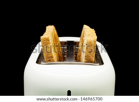 Toasted bread and toaster for breakfast. - stock photo
