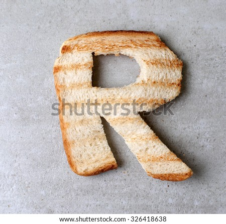 Toasted bread letters on the table