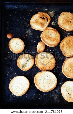 toasted bread on a baking sheet, food closeup - stock photo