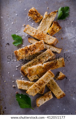 toasted bread sticks on metal baking tray