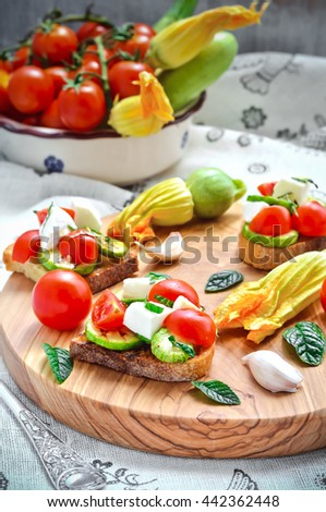 Toasted bread topped with grilled Zucchini, Mozzarella, Cherry Tomatoes, Italian Food,  - stock photo