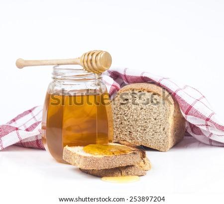 Toasted bread with honey isolated on white studio background. - stock photo