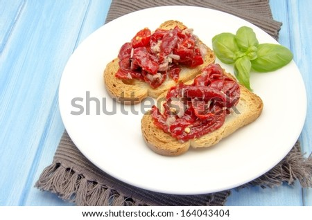 Toasted bread with red pepper salad