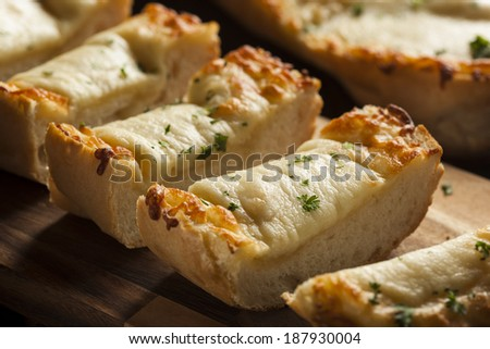 Toasted Cheese and Garlic Bread with Parsley - stock photo