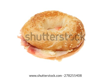 Toasted ham and cheese bagel isolated against white - stock photo