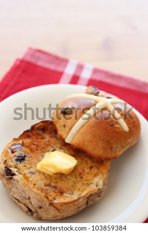 Toasted hot cross bun with butter - stock photo