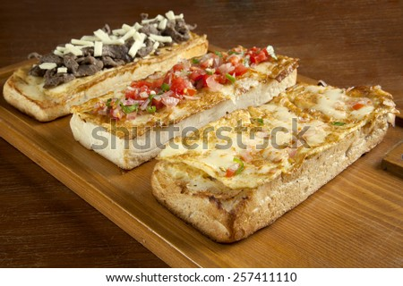 Toasted open faced omelette egg sandwich with melted mozzarella cheese - stock photo