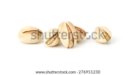Toasted pistachios closeup on white background