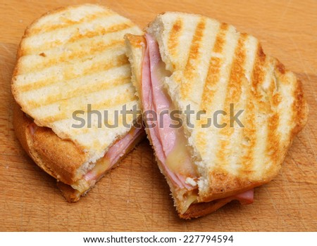 Toasted sandwich or panini with ham and cheese.