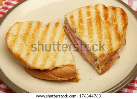 Toasted sandwich with cheese and ham.