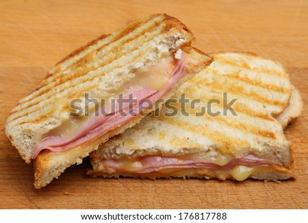 Toasted sandwich with ham and cheese - stock photo