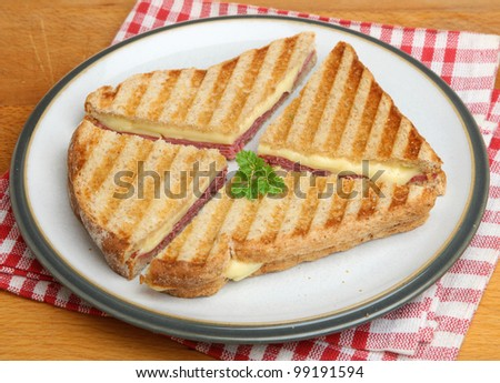 Toasted sandwich with pastrami and cheese - stock photo