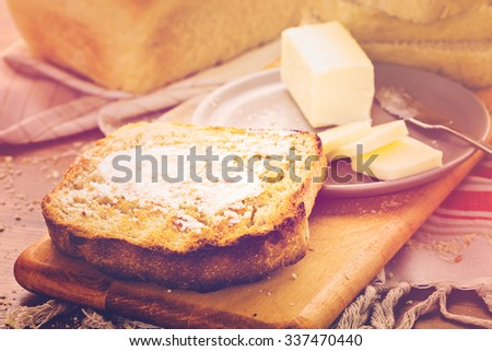 Toasted slices of freshly baked sourdough bread with butter.