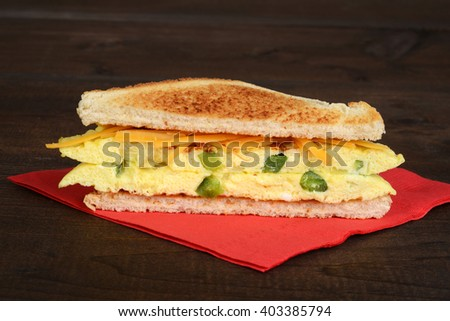 toasted western sandwich on red napkin - stock photo