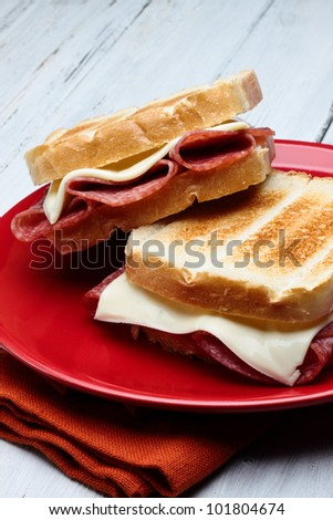 toasted white bread with salami and cheese