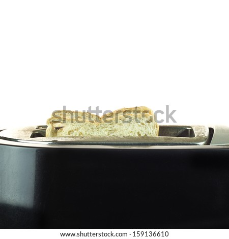Toaster and two hot toasts ready for the breakfast - stock photo