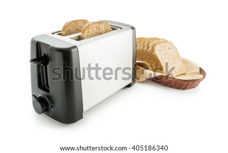 Toaster with bread slices. Electric toaster arranged with wholemeal toast bread slices placed on a cotton cloth napkin in a wicker basket isolated on white background. - stock photo