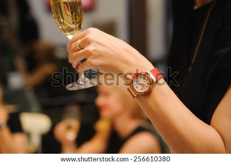 Toasting and celebrating to success with a flute of champagne - stock photo
