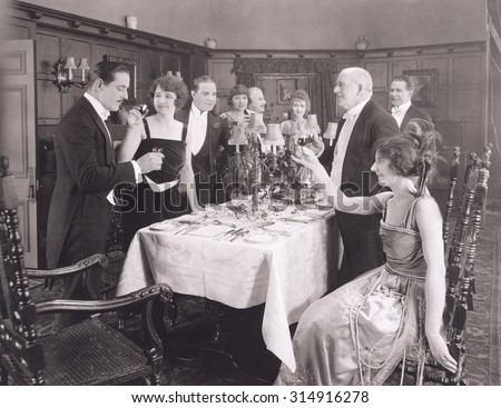 Toasting the host of dinner party - stock photo