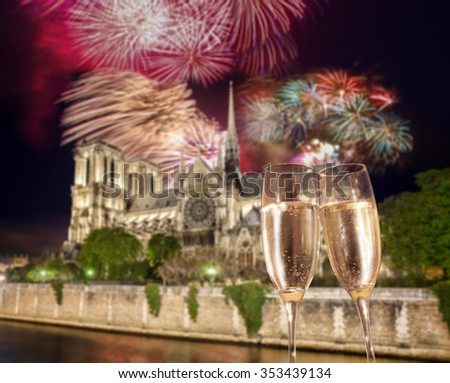 Toasting with champagne against Notre Dame with firework in Paris, France - stock photo
