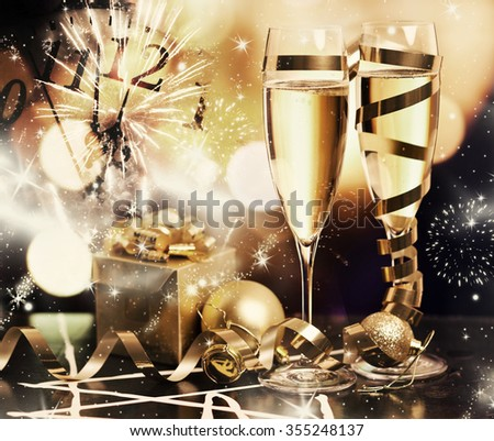 Toasting with champagne glasses against holiday lights