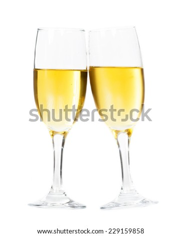 Toasting with champagne glasses isolated on white - stock photo