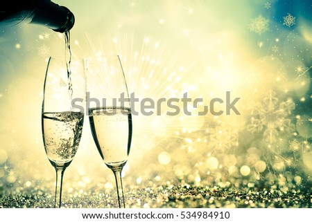toasting with champagne glasses on sparkling holiday background - Fireworks at New Year and copy space