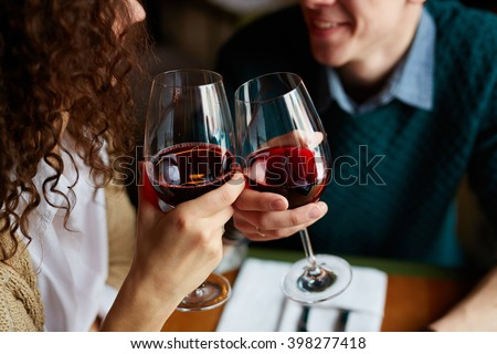 Toasting with red wine - stock photo