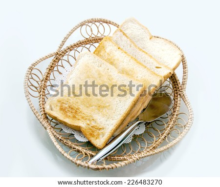 toat slide whole weet bread on rattan basket on isolate - stock photo