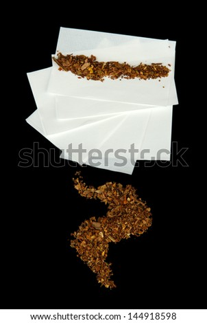 Tobacco and rolling paper, isolated on black - stock photo